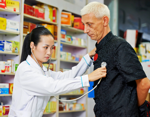 pharmacist checking patients heartbeat