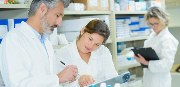 pharmacists writing drug records