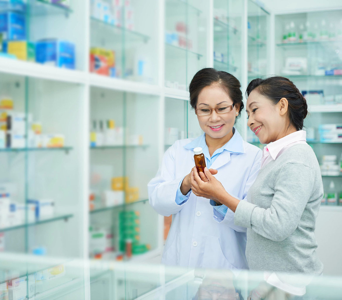 pharmacist helping customer finds the right medication