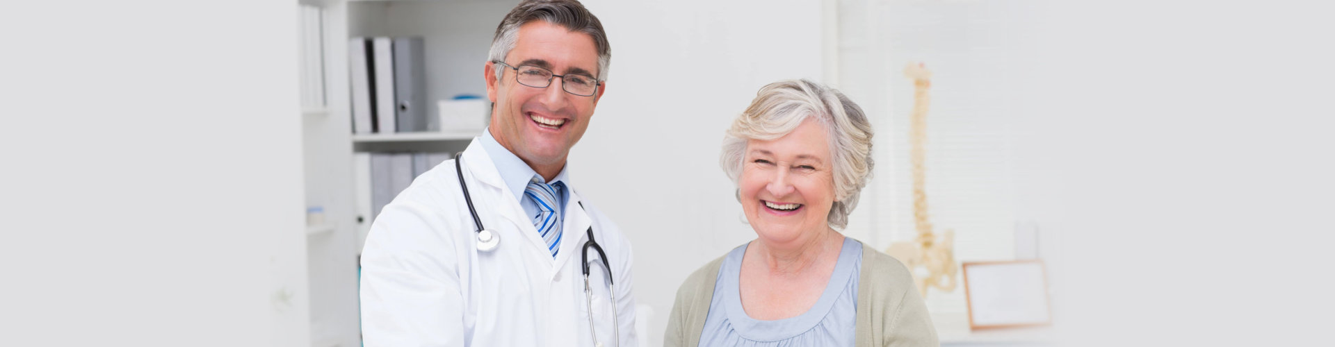 portrait of happy male doctor and female patient