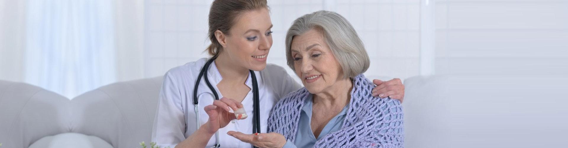 pharmacist giving patient medicine