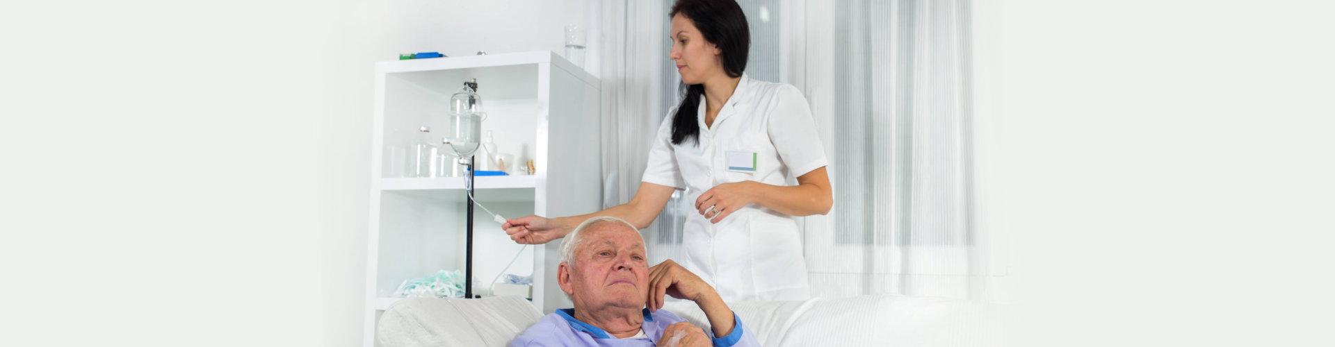 older men receives infusion in hospital