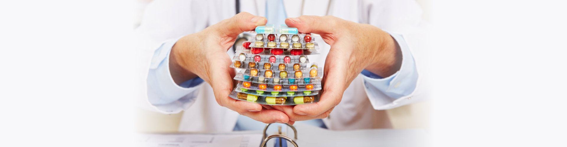 doctor holding many different colorful pills